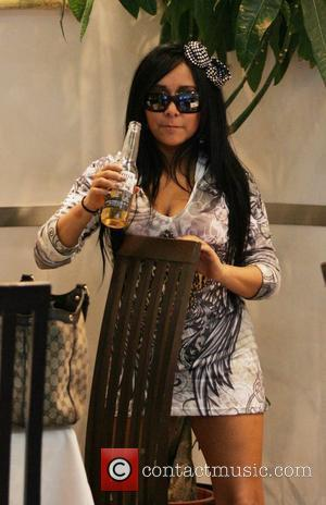 Nicole Polizzi aka Snooki filming for MTV's 'Jersey Shore'. Snooki, who is upset with her boyfriend, goes out to dinner...