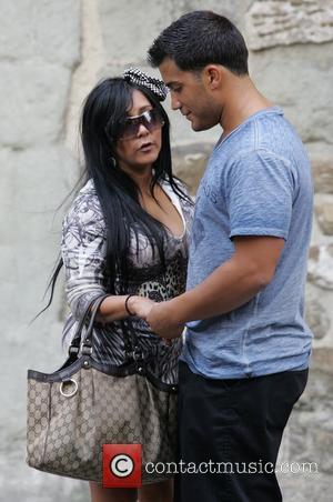 Nicole Polizzi aka Snooki and Jionni LaValle Nicole Polizzi aka Snooki filming with her boyfriend for MTV's 'Jersey Shore'. Snooki...