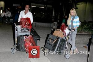 Jimmy Esebag and Sophie Monk  Sophie Monk arriving at LAX airport with her fiance, after returning from a romantic...