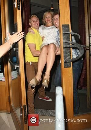 Amanda Holden is carried out of Sophie`s Steakhouse and Bar and to her car by two male friends after celebrating...