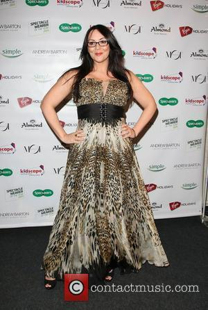 Martine Mccutcheon Rocks 'Librarian Look' At Awards Show