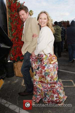 Anne Heche and boyfriend James Tupper The 2011 Film Independent Spirit awards held at Santa Monica Beach - Press Room...