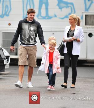 Steven Gerrard and Alex Curran