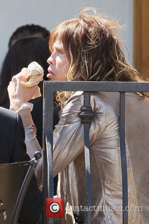 Steven Tyler eating lunch at Urth Caffe with friends Los Angeles, California - 08.04.11