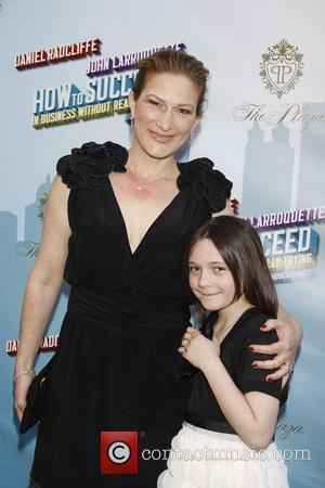 Ana Gasteyer and her daughter Frances Mary McKittrick  Opening Night of the Broadway musical production of 'How To Succeed...