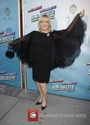 Candy Spelling wearing Marchesa Opening Night of the Broadway musical production of 'How To Succeed In Business Without Really Trying'...