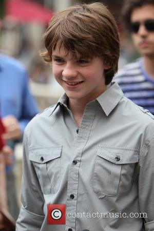 Joel Courtney Cast members of 'Super 8' at The Grove, for an interview with Mario Lopez on 'Extra' Los Angeles,...