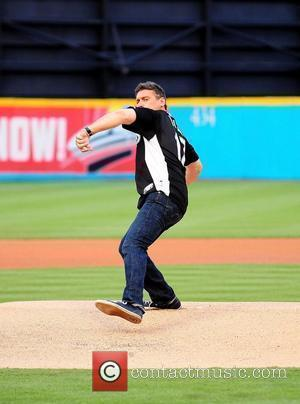 Steven Bauer throw the first pitch during the Florida Marlins Vs. The Washington National Baseball game at Sun Life Stadium....