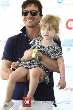 Matthew Settle and daughter Aven  Super Saturday 14 in Watermill to benefit Ovarian Cancer Research Watermill, New York -...