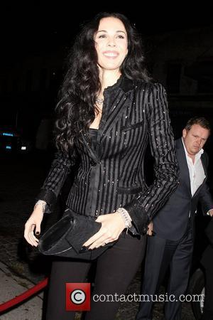 L 'Wren Scott  Members of Sir Mick Jagger's new supergroup Superheavy celebrate the release of their self-titled album at...