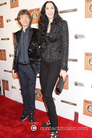 Mick Jagger and L 'Wren Scott Members of Sir Mick Jagger's new supergroup Superheavy celebrate the release of their self-titled...