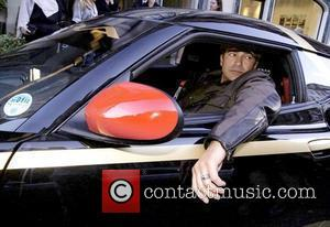 Tamer Hassan checks out the Lotus Evora S that he will be driving whilst competing in the 2011 Gumball 3000...