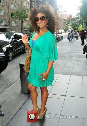 Tanika Ray out and about in Midtown in a green dress and sunglasses New York City, USA - 21.06.11