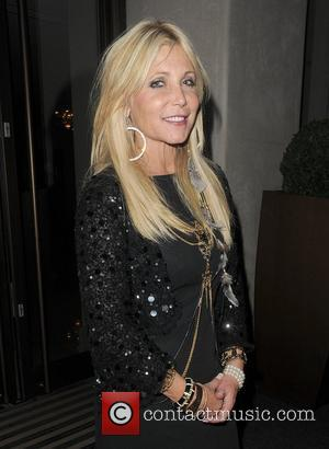 Pamela Bach Hasselhoff arriving back to her hotel. London, England - 09.09.11