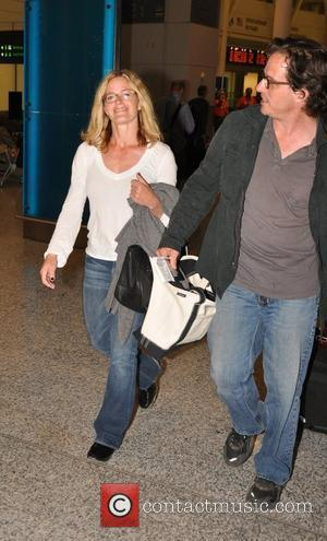 Elisabeth Shue and her director husband Davis Guggenheim arrive at at Toronto Pearson International Airport for the Toronto International Film...