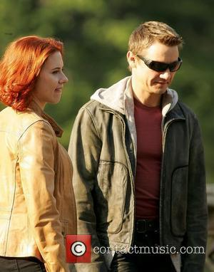 Scarlett Johansson and Jeremy Renner actors on the set of 'The Avengers' shooting on location in Manhattan New York City,...