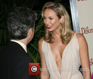Director Alexander Payne and Stacy Keibler The Descendants Los Angeles Premiere held at Samuel Goldwyn Theater Academy of Motion Picture...
