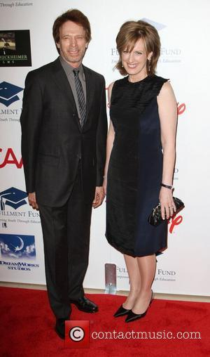 Jerry Bruckheimer and Anne Sweeney The Fulfillment Fund's 2011 Stars Gala held at The Beverly Hilton Hotel Beverly Hills, California...