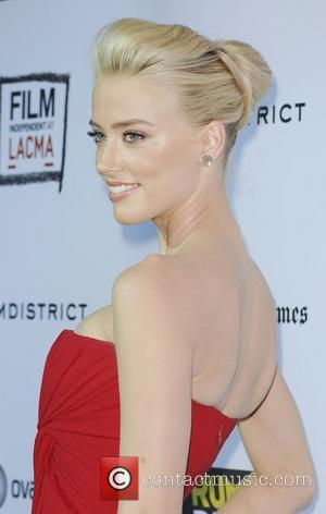 Amber Heard,  at 'The Rum Diary' premiere held at the LACMA Bing Theater - Arrivals Los Angeles, California -...
