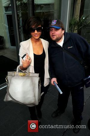 Frankie Sandford with fan Stephen Jones The Saturdays leave their hotel in Manchester and head to Sheffield Manchester, England -...