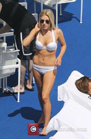 Mollie King of The Saturdays in her bikini relaxing by the pool at their hollywood hotel Los Angeles, California -...