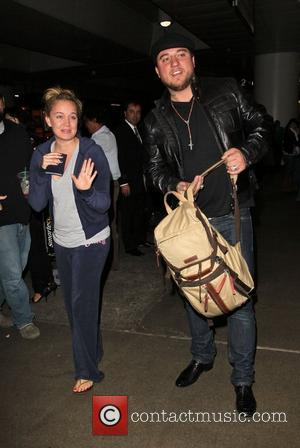 Tiffany Thornton and her fiance Christopher Carney arrive at LAX airport after flying in from London Los Angeles, California -...