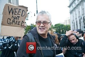 Tim Robbins speaks to Occupy Wall Street protesters at the start of a rally held at Foley Square, Manhattan. A...