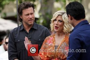 Dean McDermott and Tori Spelling  filming an interview with Mario Lopez for the entertainment television news programme 'Extra' at...