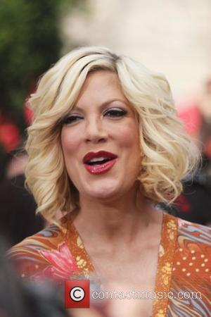 Tori Spelling Adopts Baby Pig