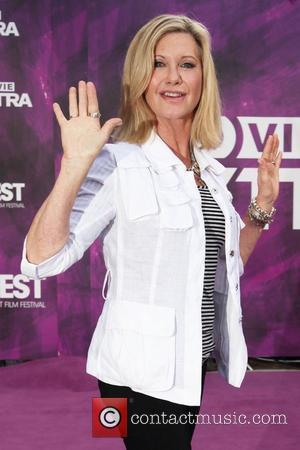 Olivia Newton-john 'Very Sad' Over Conaway's Death