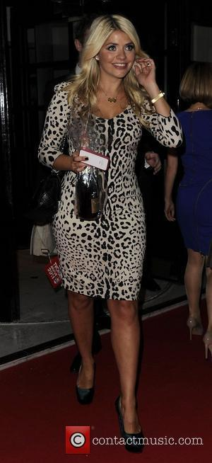 Holly Willoughby leaving the TV choice awards. London, England - 13.09.11