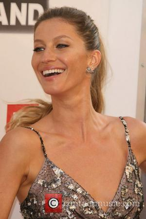 Gisele BüNdchen Practices Yoga With Baby Vivian