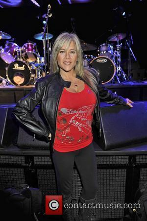 Samantha Fox poses at an Adam Ant concert where he was promoting his UK tour at 'Under The Bridge' in...