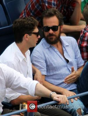 Peter Sarsgaard watches Novak Djokovic of Serbia play against Rafael Nadal of Spain during the Men's Final on Day 15...