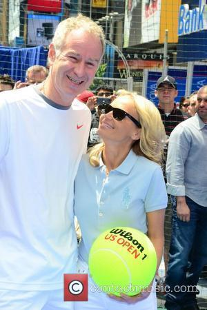 John McEnroe and Kristin Chenoweth 2011 U.S. Open ticket sales launch in Times Square  New York City, USA -...