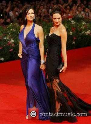 Asia Argento and Manuela Arcuri The 68th Venice Film Festival - Day 2 - 'Carnage' - Red Carpet Venice, Italy...