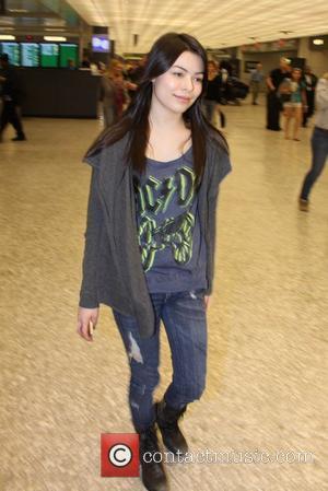 Miranda Cosgrove at Washington Dulles airport Washington DC, USA - 20.03.11