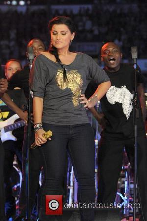 Nelly Furtado Makes Charity Donation With Gaddafi Cash