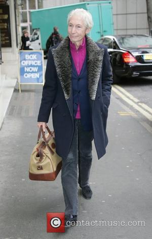 Rolling Stones drummer Charlie Watts walking in London's West End London, England - 09.03.11