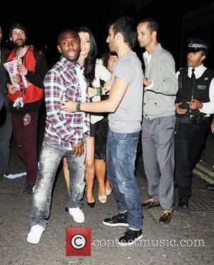 Shaun Wright-Phillips  is restrained by friends as he argues with the police while leaving Whisky Mist nightclub London, England...