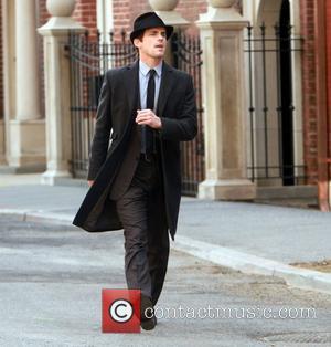 Matthew Bomer shooting on location for 'White Collar' New York City, USA - 18.03.11