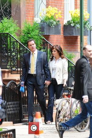 Tim DeKay and Tiffani Thiessen filming on location for 'White Collar' on the streets of Manhattan,  New York City,...