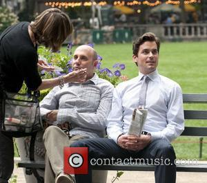 Willie Garson and Matthew Bomer on the film set for their show 'White Collar' shooting in Bryant Park New York...