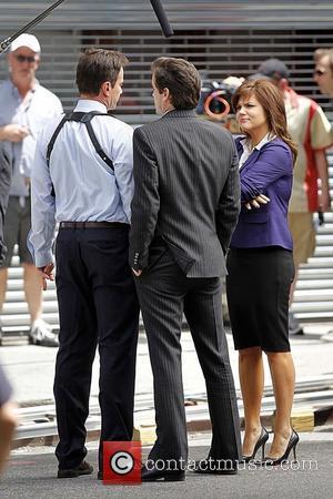 Tim DeKay, Matthew Bomer and Tiffani Thiessen filming on the set of 'White Collar' in Manhattan New York City, USA...