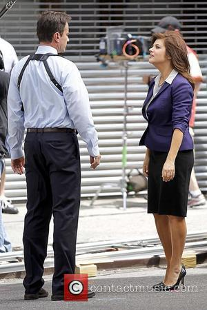 Tim DeKay and Tiffani Thiessen shooting on the set of 'White Collar' in Manhattan New York City, USA - 30.06.11