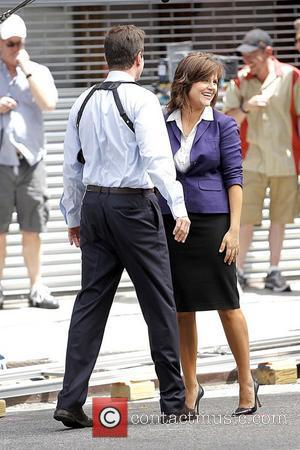 Tim DeKay and Tiffani Thiessen filming on the set of 'White Collar' in Manhattan New York City, USA - 30.06.11