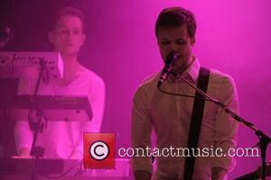 Harry McVeigh  English alternative rock band 'White Lies' performing on stage at The Mod Club Theatre.  Toronto, Canada...
