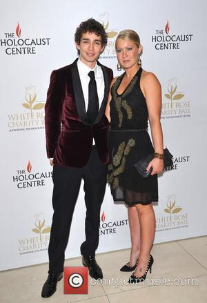 Robert Sheehan and guest White Rose charity ball held at the Park Plaza Riverside - Arrivals. London, England - 25.09.11