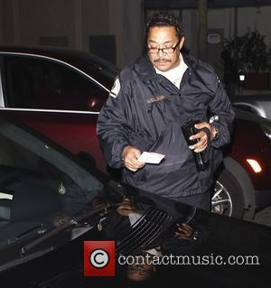 A parking attendant places a parking ticket on Will Smith's outside Beso Restaurant in Hollywood Los Angeles, California, USA -...