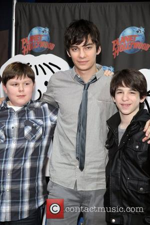 Robert Capron and Devon Bostick